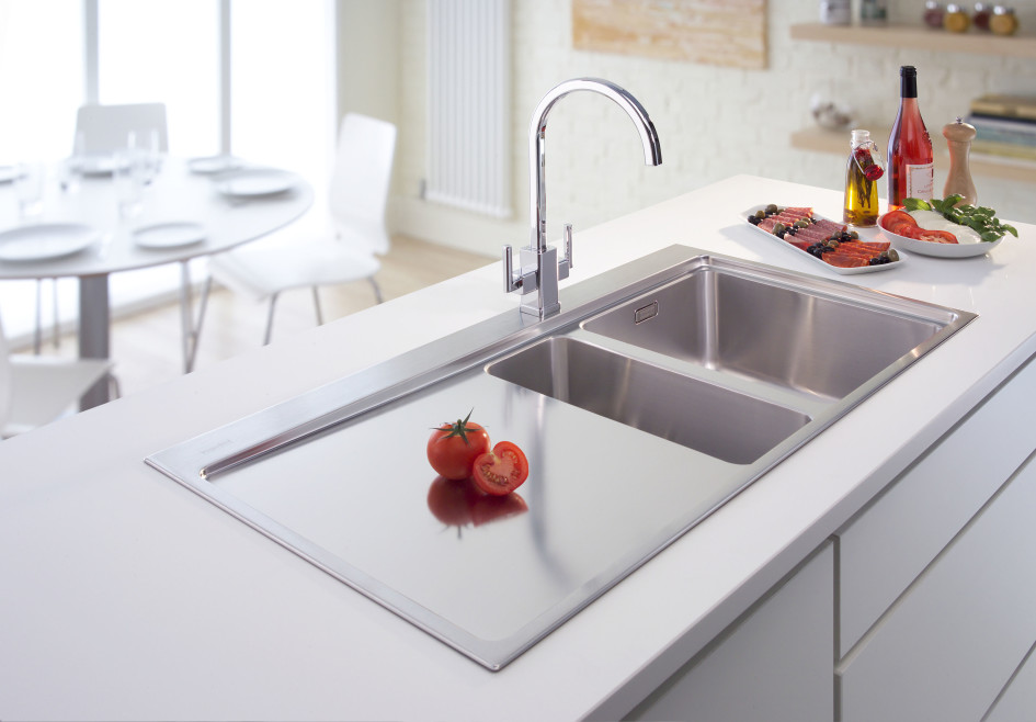 stunning-twin-stainless-steel-kitchen-sink-with-captivating-arch-water-tap-on-enchanting-white-countertop-intriguing-round-dining-table-945x658